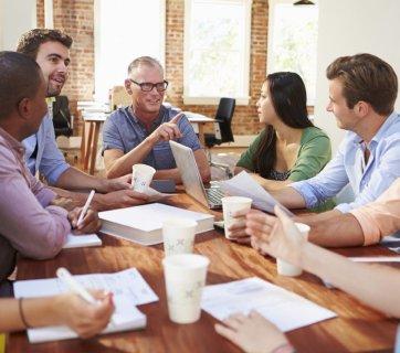 Employees Attending Meeting